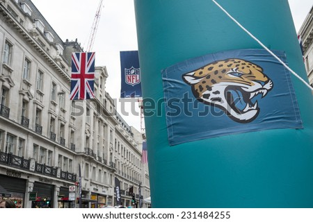 LONDON, UK - SEPTEMBER 27: Jacksonville Jaguars banner and NFL flags above in Regent Street. September 27, 2014 in London. The street was closed to traffic to host NFL related games and events. - stock photo