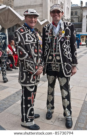 LONDON, UK-SEPTEMBER 25: (L-R) The Pearly King of Crystal Palace, Pat Jolley with the Pearly Prince of Finsbury, Darren Walters attend the Harvest Festival Parade on September 25, 2011 in London, UK. - stock photo