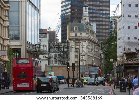 LONDON, UK - SEPTEMBER 12, 2015: Liverpool street train station street with transport and people