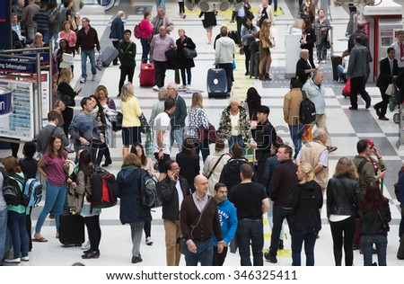 LONDON, UK - SEPTEMBER 12, 2015: Liverpool street train station with lots of people, waiting for boarding, looking for information and walking through the hall - stock photo