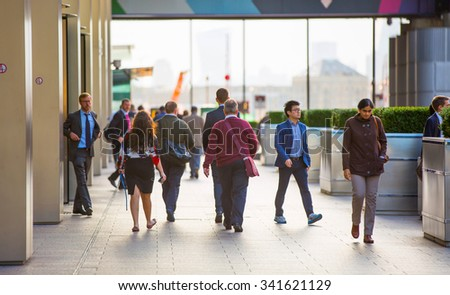 LONDON, UK - SEPTEMBER 9, 2015: Office workers going home after working day in Canary Wharf. Business life of London - stock photo