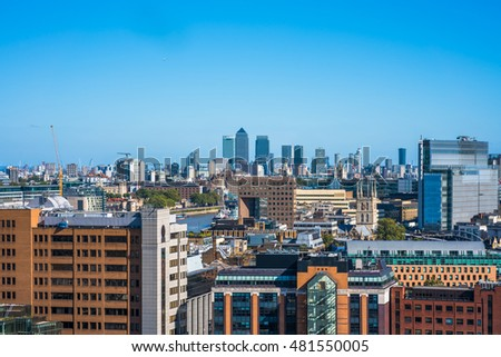 LONDON UK - SEPTEMBER 11, 2016: Panoramic aerial view of London including modern skyscrapers which form Canary Wharf - the financial district of London