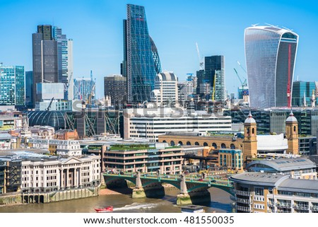 LONDON UK - SEPTEMBER 11, 2016: Panoramic view of London with iconic modern skyscrapers including Walkie-Talkie, Tower 42, Lloyds bank which form business and banking area in London