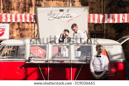 London, UK - 19 September 2015: Pop-up food stall in a vintage van with hipster chefs selling lobster and burger in the trendy London area of Shoreditch. - stock photo