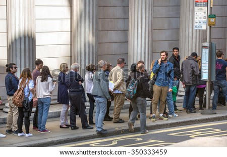 LONDON UK - SEPTEMBER 19, 2015: Queue on the Bank street. People waiting to see Bank of England in open day event - stock photo