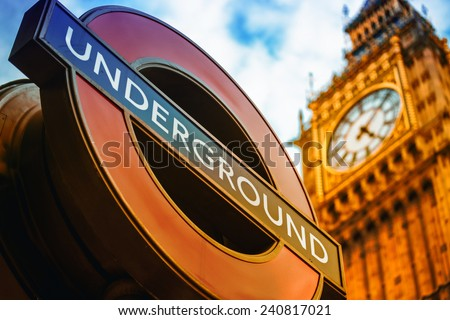 LONDON, UK - SEPTEMBER 27, 2013: Symbols of London - Underground sign and Big Ben clock tower - stock photo