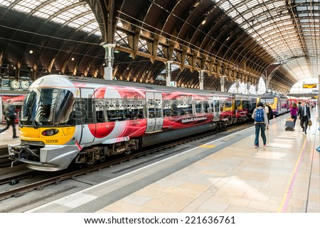 LONDON, UK - SEPTEMBER 26, 2014: The Heathrow Express train with Vodafone commercials promoting high speed internet is waiting at the beautiful Paddington Station on September 26, 2014 in London, UK. - stock photo