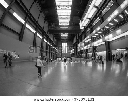 LONDON, UK - SEPTEMBER 28, 2015: The Turbine Hall Tate Modern art gallery seen with fisheye lens in black and white