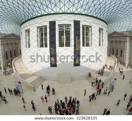 LONDON, UK - SEPTEMBER 28, 2015: Tourists in the Great Court at the British Museum designed by architect Lord Norman Foster opened in year 2000 seen with fisheye lens