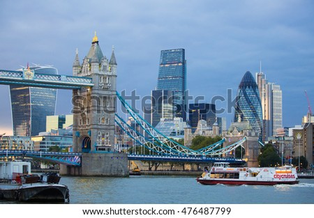 LONDON, UK - SEPTEMBER 19, 2015: Tower bridge and Gherkin building. View from the embankment at sunset