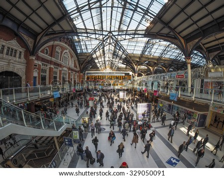 LONDON, UK - SEPTEMBER 28, 2015: Travellers at Liverpool Street Station seen with fisheye lens - stock photo