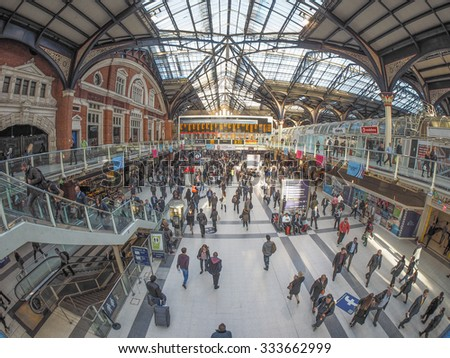 LONDON, UK - SEPTEMBER 28, 2015: Travellers at Liverpool Street Station seen with fisheye lens