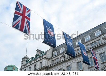 LONDON, UK - SEPTEMBER 27: Union Jack and NFL banners hanging in Regent street. September 27, 2014 in London. Regent street was closed to traffic to host NFL related games and events. - stock photo