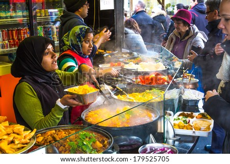 LONDON, UK - 1ST MARCH 2014: People buying food at Camden Food Market - stock photo