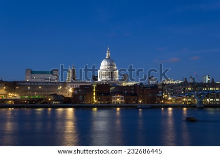 LONDON, UK - 19TH JANUARY 2014: St Pauls Cathedral from across the Thames at dusk - stock photo