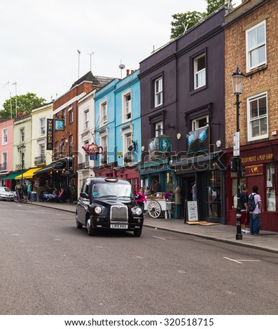 LONDON, UK - 16TH JULY 2015: Buildings along Portobello Road in Nottinghill, London, during the day, showing buildings shops and people. - stock photo