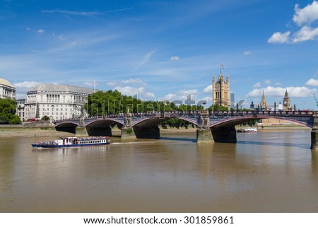 LONDON, UK - 18TH JULY 2015: Lambeth Bridge, a boat and Houses of Parliament in London during a day in the summer.