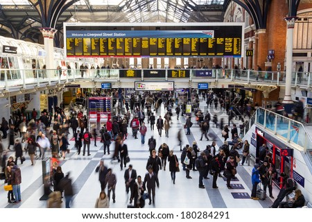 LONDON, UK - 4TH MARCH 2014: Liverpool Street Station at Rush our in the morning showing many people moving around - stock photo