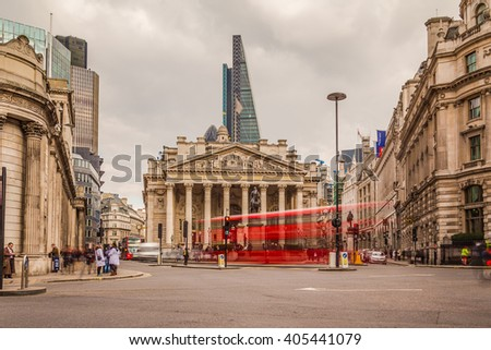 LONDON, UK - 25TH MARCH 2015:  The Bank of England during the day at Bank Junction showing buildings and the blur of people and traffic - stock photo