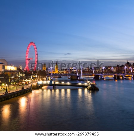 LONDON, UK - 10TH MARCH 2015: The Westminster Skyline from the East showing the London Eye, Hungerford Bridge, Westminster and other buildings - stock photo