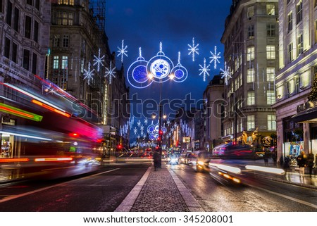 LONDON, UK - 27TH NOVEMBER 2015: A view along The Strand in London at night during the Christmas Season showing the streets and decorations. Traffic and people can be seen.