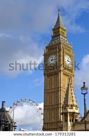 LONDON, UK - 27TH NOVEMBER 2014: A view of Big Ben and the London Eye in London. - stock photo