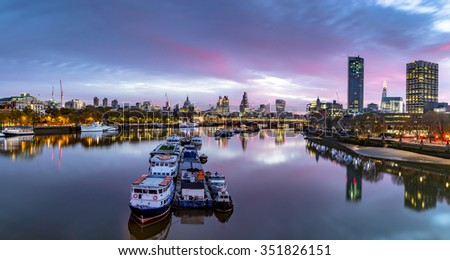 LONDON, UK - 8TH NOVEMBER 2015 : Panoramic View  at sunrise showing buildings in central London including, Tower 42 Gherkin,Willis Building, IBM, Stock Exchange Tower and Lloyd`s of London. - stock photo