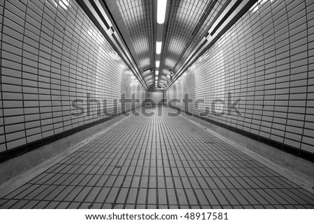 London Underground Tottenham Court Road, pedestrian tunnel for crossing the different tube lines - stock photo