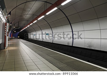 London underground train station with a view of the tunnel entrance. - stock photo