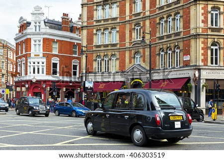 London, United Kingdom - April 3, 2016: Iconic black cabs on the Cambridge Circus on April 3, 2016. Cabs are widespread transport in the London. - stock photo