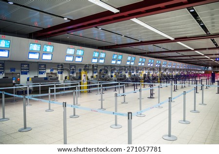 LONDON, UNITED KINGDOM - April 12, 2015: Interior with empty check-in lines on Luton airport in London, UK - stock photo