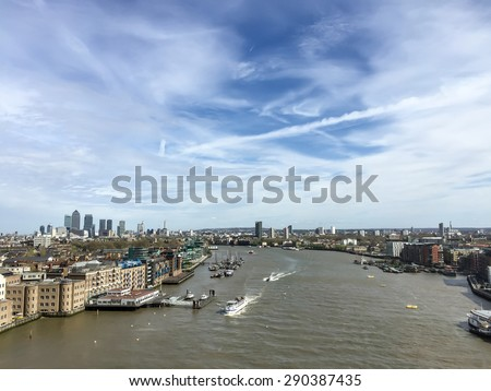 LONDON, UNITED KINGDOM - APRIL 18, 2015: Landscape of Thames river from the Tower Bridge. London is the world's leading financial centre for international business and commerce. - stock photo