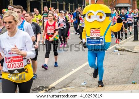 London, United Kingdom - April 24, 2016: London Marathon 2016. Runners in great costumes. Minion costume - stock photo