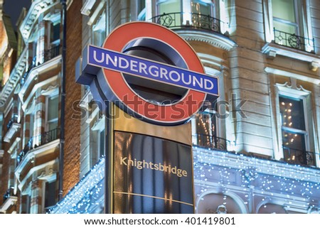 LONDON, UNITED KINGDOM - 2 April 2016: The signage for the London Underground (tube) station on Brompton Road at Knightsbridge Station on the Piccadilly Line.  - stock photo