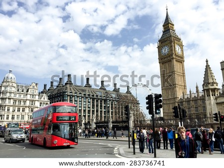 LONDON, UNITED KINGDOM - APRIL 16, 2015: tourists at Westminster and the most famous London landmark Big Ben. London is the world's most-visited city as measured by international arrivals. - stock photo
