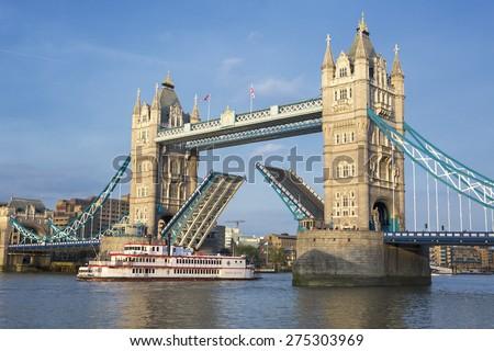 LONDON, UNITED KINGDOM - APRIL 13: Tower Bridge in London on April 13, 2015. Famous Tower Bridge at Thames RIver in London, United Kingdom. - stock photo