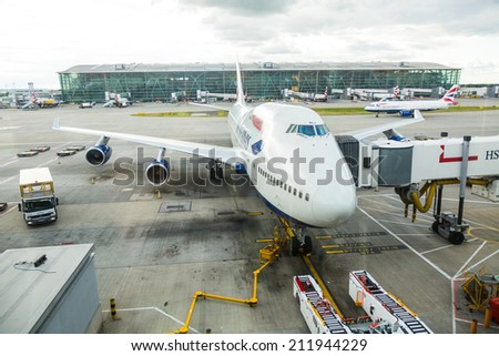 LONDON, UNITED KINGDOM - AUGUST 19, 2014: British Airways Boeing 747 at London Heathrow airport with some more aircrafts on background - stock photo