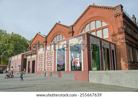 LONDON, UNITED KINGDOM - AUGUST 28, 2014: Families visiting the Museum of Childhood in Bethnal Green, London.  The museum, dedicated to toys and is part of the Victoria and Albert Museum. - stock photo