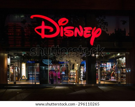 LONDON, UNITED KINGDOM - CIRCA JUNE 2015: Disney Store exterior night view in Oxford Street. Disney Store chain was founded in 1987 and has 479 locations. - stock photo