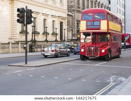 LONDON, UNITED KINGDOM - CIRCA NOVEMBER 2013:Red vintage bus in London - stock photo