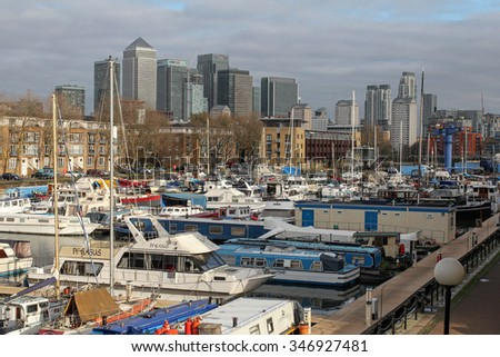 LONDON, UNITED KINGDOM - DECEMBER 1, 2015: yachts in South Dock Marina and skyscrapers of Canary Wharf in London.  - stock photo