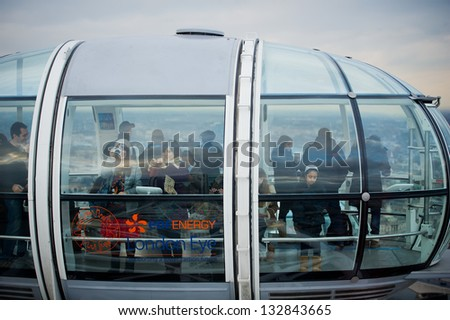 LONDON, UNITED KINGDOM - FEBRUARY 17, 2012: A Participants of attraction London Eye in a cabin of a wheel of a review on February 17, 2012 in London, United Kingdom of Great Britain. - stock photo