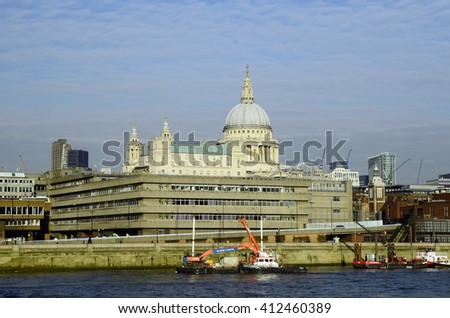 LONDON, UNITED KINGDOM - JANUARY 19: Different buildings along river Thames and St. Pauls cathedral behind, on January 19, 2016 in London, England