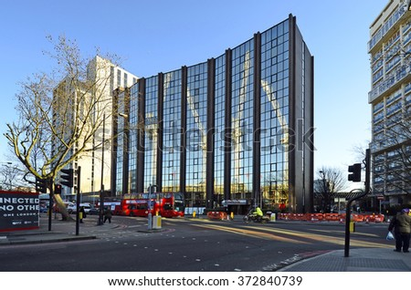 LONDON, UNITED KINGDOM - JANUARY 15: Office building in Southwark with reflection of cranes, on January 15, 2016 in London, England, Great Britain