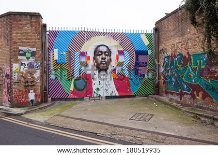 LONDON, UNITED KINGDOM - JANUARY 12, 2014: Shoreditch, in the heart of the trendy East End of London, has become synonymous with the UK street art scene, attracting visitors from all over the world. - stock photo