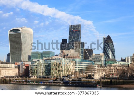 LONDON, UNITED KINGDOM - 25 JANUARY 2016: Tower of London and city skyscrapers view over Thames River, London, UK. - stock photo