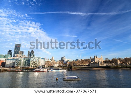 LONDON, UNITED KINGDOM - 25 JANUARY 2016: Tower of London and city skyscrapers view over Thames River, London, UK.