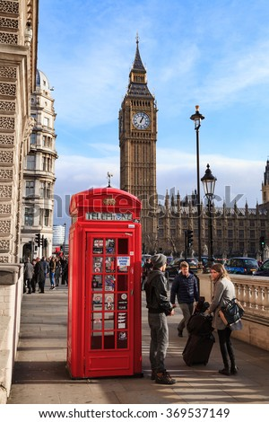 LONDON, UNITED KINGDOM â?? 25 JANUARY 2016: Traditional Red Telephone Box and Big Ben in London, UK - stock photo