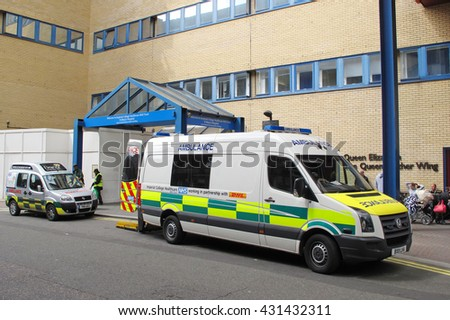 LONDON, UNITED KINGDOM - JULY 19, 2012: Ambulance car in entrance of St Mary's Hospital, Imperial College Healthcare NHS Trust. - stock photo