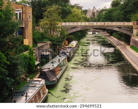 LONDON, UNITED KINGDOM - JULY 17: Houseboats on the Regent's Canal in London on 17 July 2011. London ZOO visible in the background. - stock photo